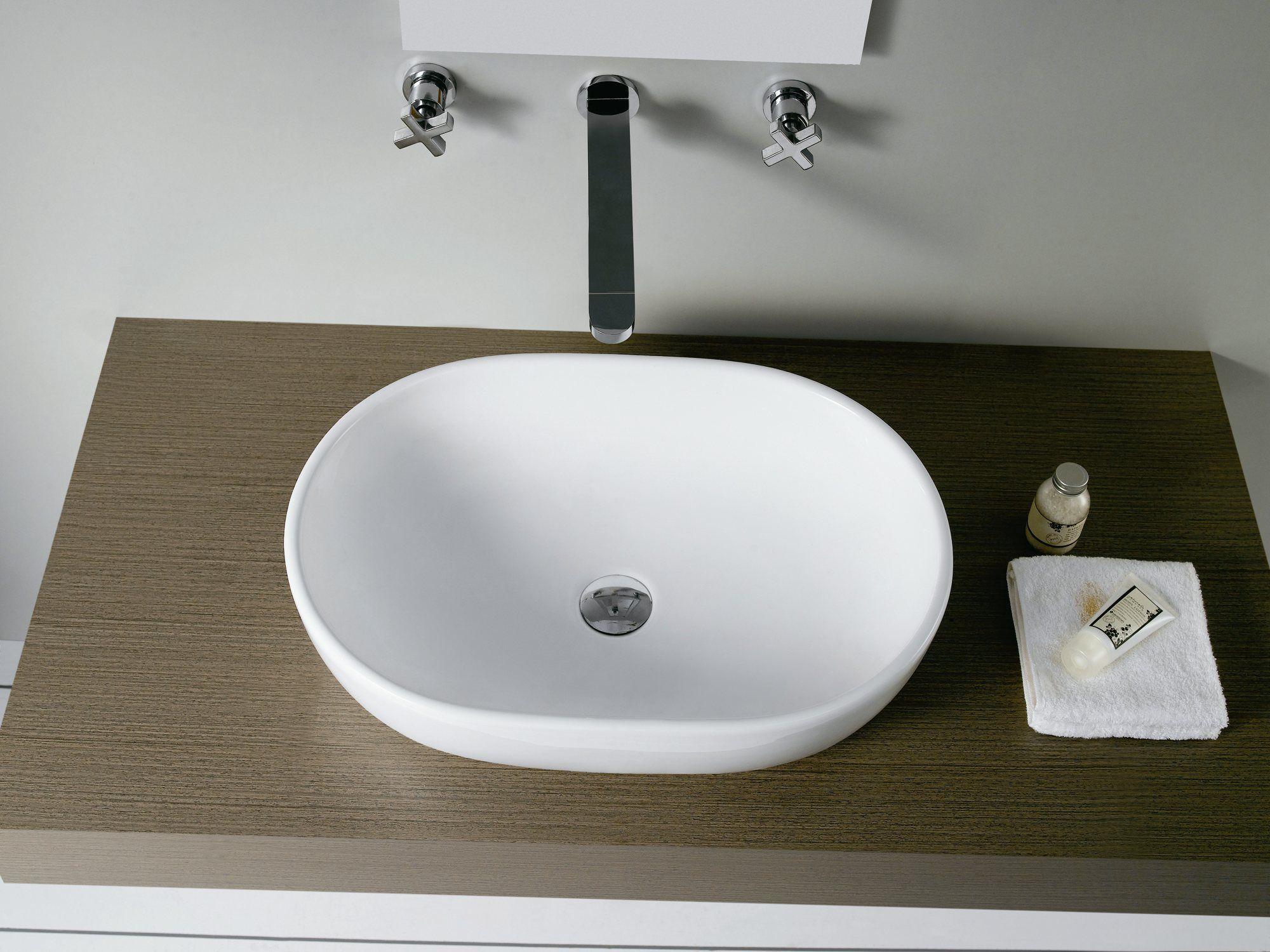 Lavabo toulouse oval de porcelana sobre encimera sin for Embellecedor rebosadero lavabo