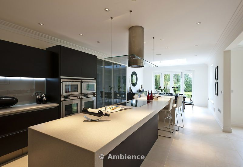 View Of Minimalist Kitchen Dining Room With Large Island Unit Breakfast Bar In A New Build House Virginia Water Surrey On Ambience Images From Arcaid