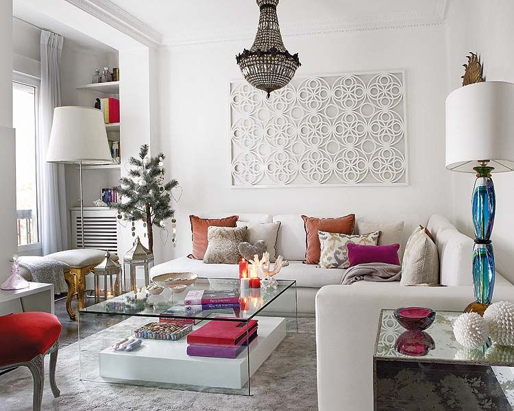 This white room incorporates classic lighting with some modern design twists = a very eclectic look that we love!