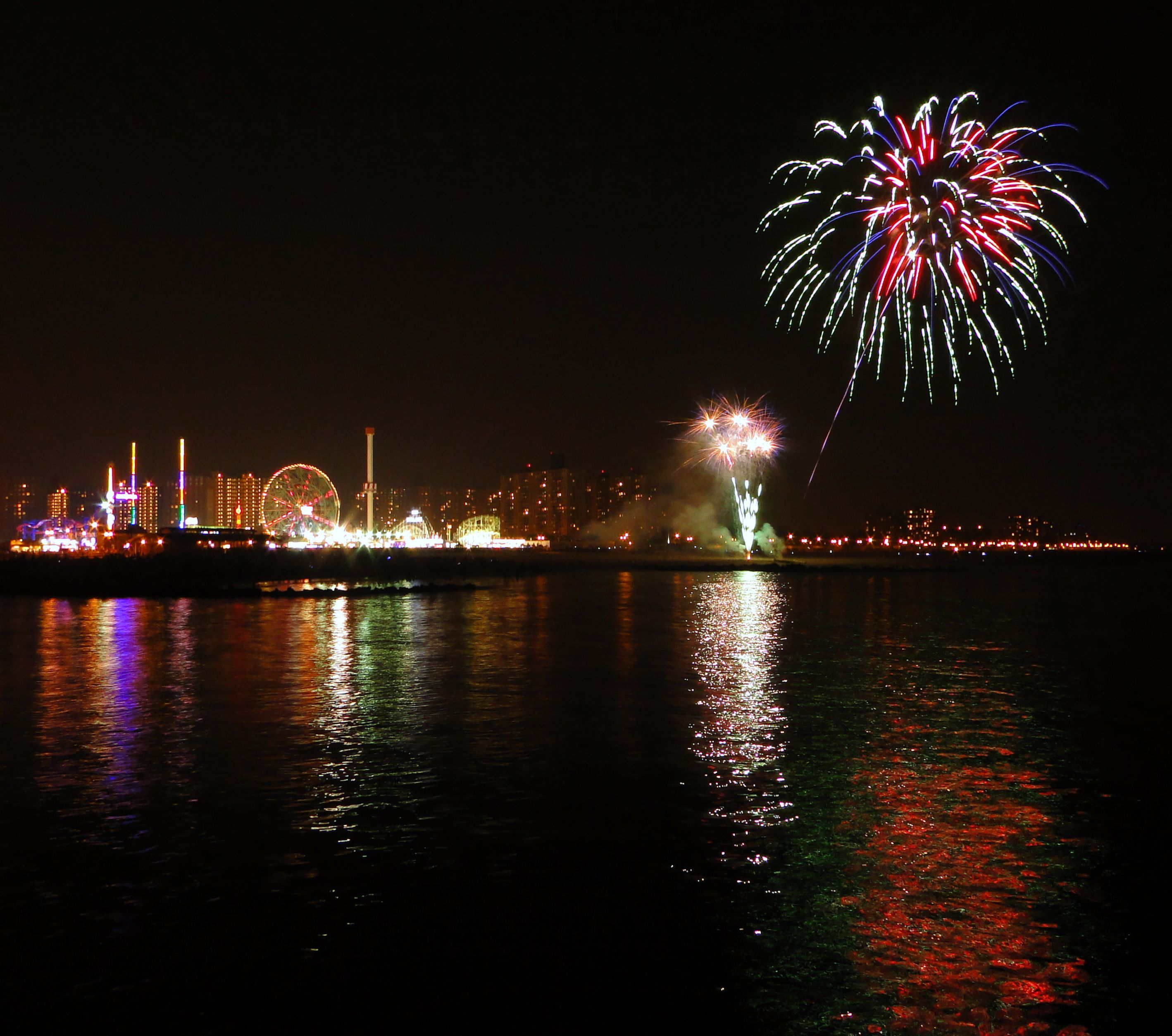 Coney Island Beach: Colorful Fireworks Over The Ocean At Coney Island (beach