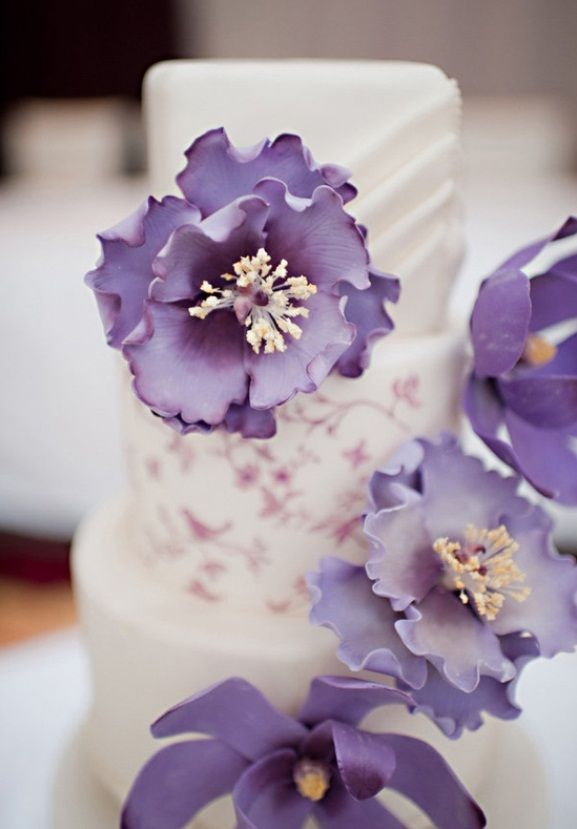 Elegant Purple Flowers On White Wedding Cake
