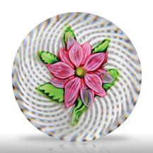 Antique Saint Louis pink clematis on latticinio swirl paperweight.