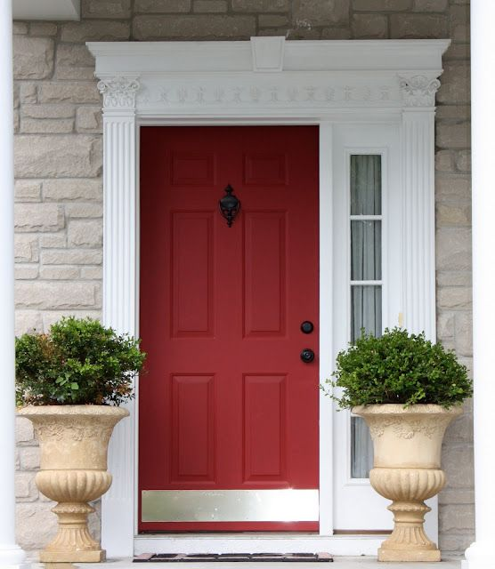 boxwoods in urns - I love the red door. Wonder if our HOA would ...