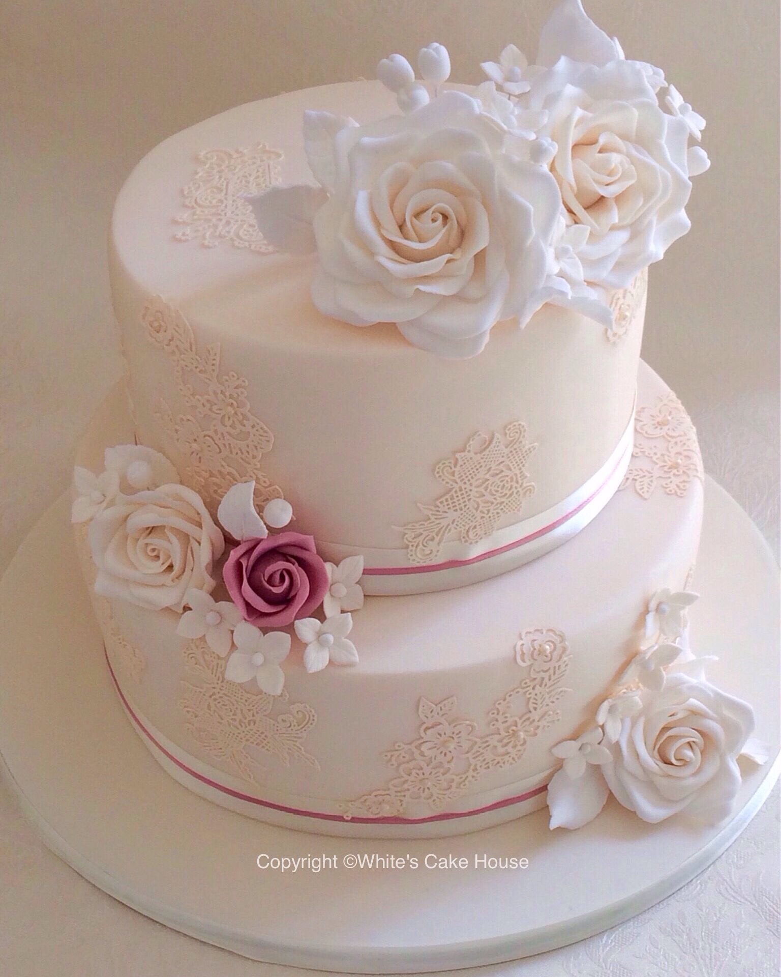 two tier wedding cakes with roses a pretty two tier wedding cake with lace and large sugar 21373