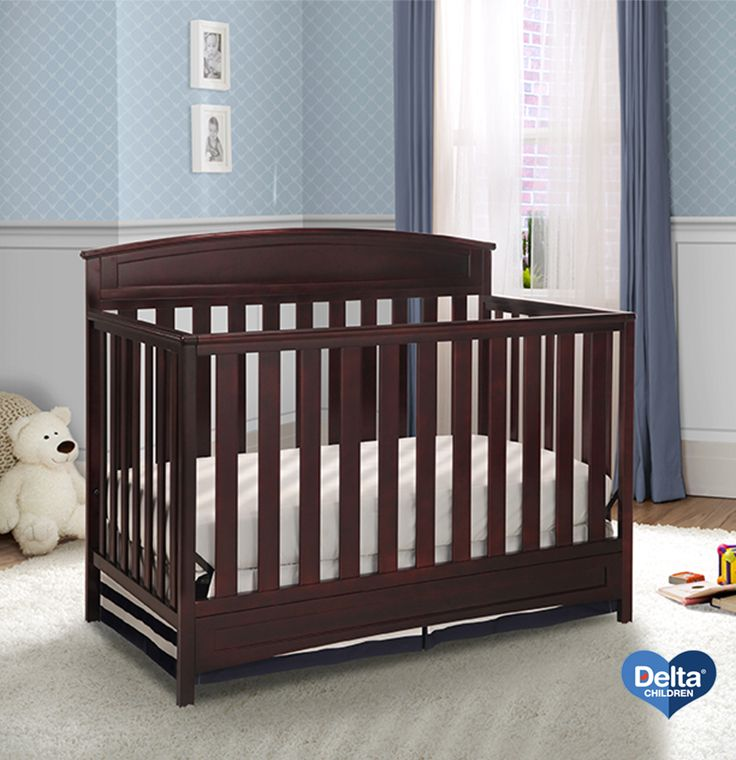 We Love How The Dark Color Of This Delta Children Crib Complements A Baby Blue Nursery