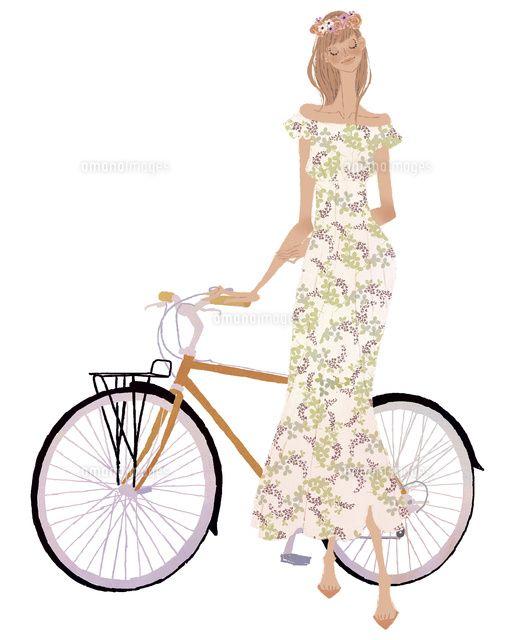 自転車に手をかける花柄のワンピースを着た女性 C Yuko Yoshioka 女性 ワンピース 花柄
