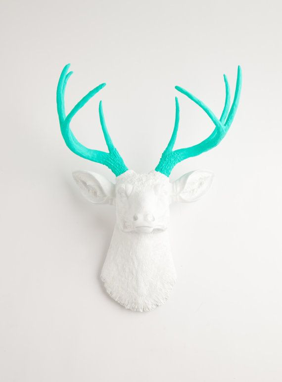 The Oleg - White W/ Turquoise Antlers Resin Deer Head- Stag Resin White Faux Taxidermy. $129.99, via Etsy.