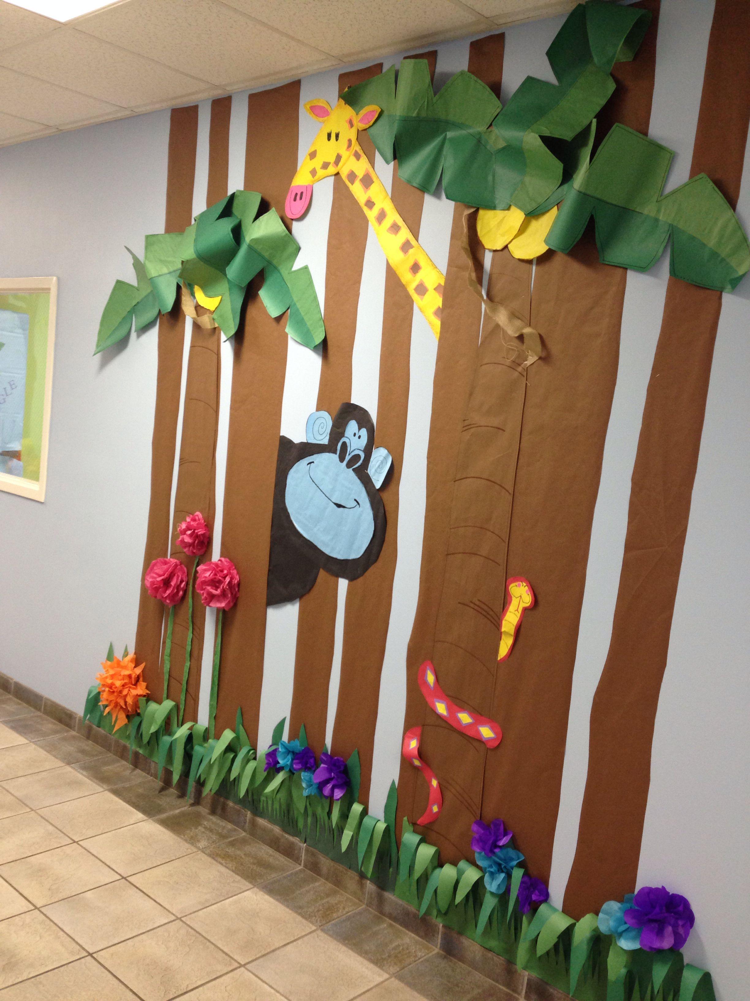 Giraffe and gorilla rumble in the jungle preschool hall for Rainforest decorations