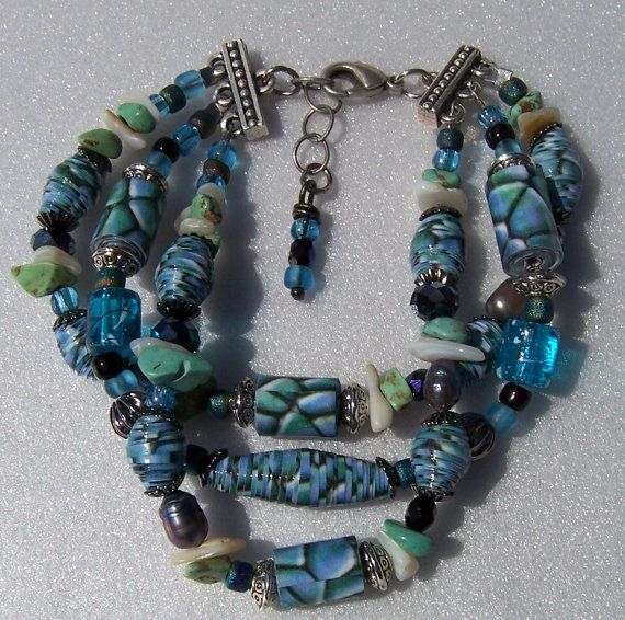 Hand made triple strand paper bead bracelet. Use different shapes for paper beads