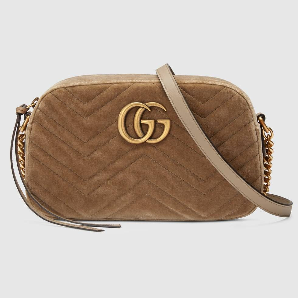 3f92ba75b243 Shop the GG Marmont velvet small shoulder bag by Gucci. The small GG Marmont  chain shoulder bag has a softly structured shape and a zip top closure with  the ...