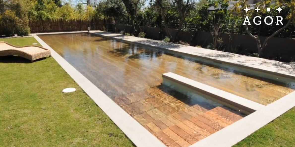 These Floors Sink Into The Ground To Become Swimming Pools Disappearing Pool Hidden Pool Pool Cover
