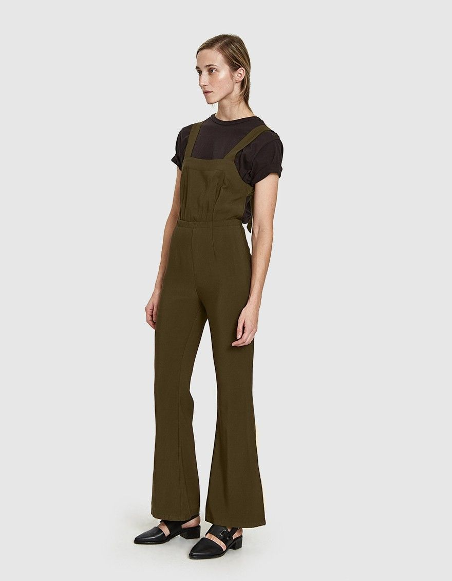 63ba6607023e Flare leg jumpsuit from Stelen in Khaki. Square neckline. Open back with  tie detail. Gathered elastic waist. Back zip closure. Slim leg flares at  knee.