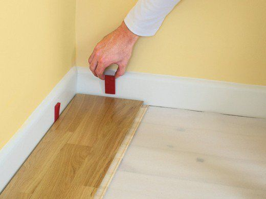Lay First Board From The One Corner Of The Room With Expansion Spacers At The Both Ends Laminate Flooring Installing Laminate Flooring Laying Laminate Flooring