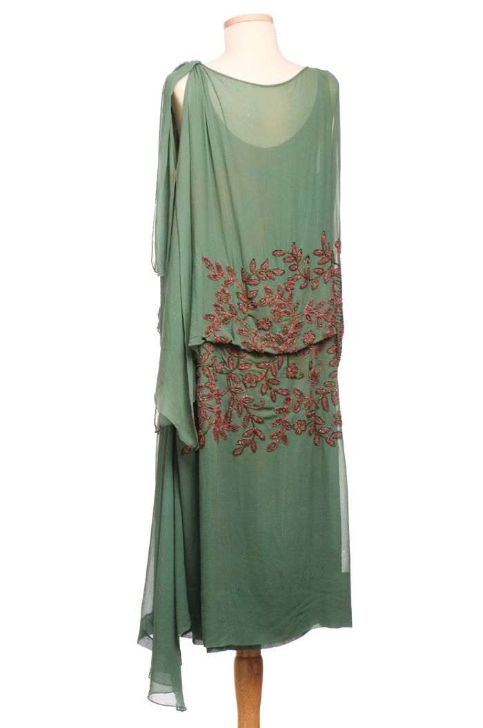 Nile green shift, 1920s, featuring bronze and rose beadwork and delicate metallic embroidery. Charleston Museum