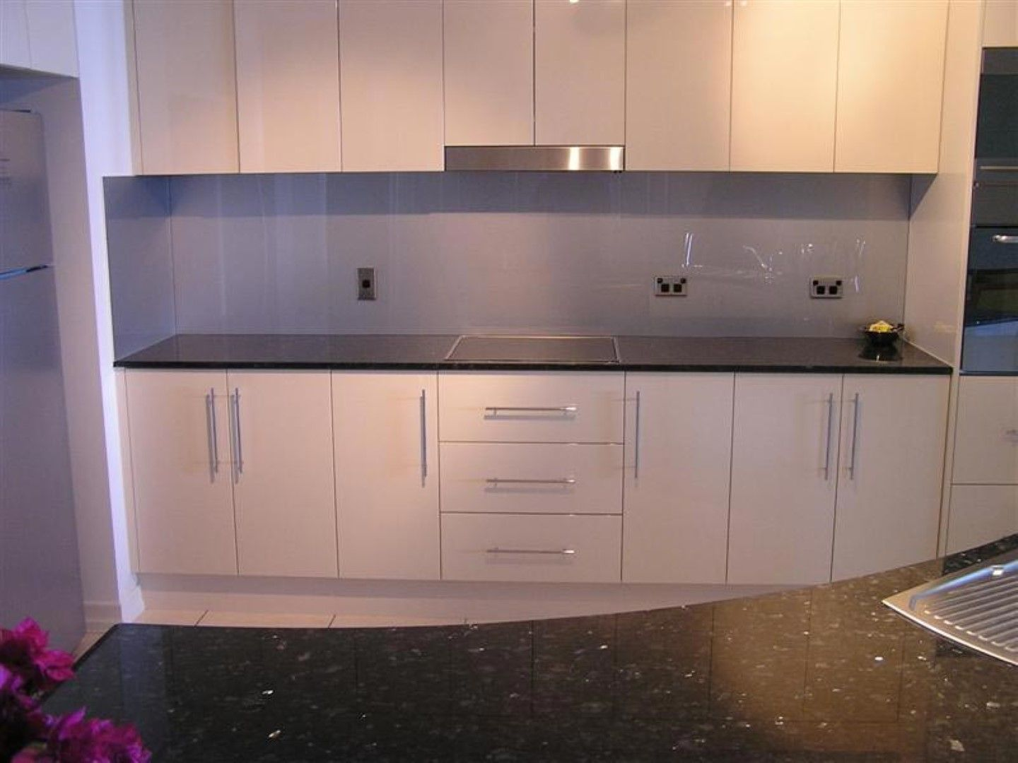 Nice Home Design, Trendy Grey Backsplash Design For Extravagant White Kitchen  With Curvy Island Table: