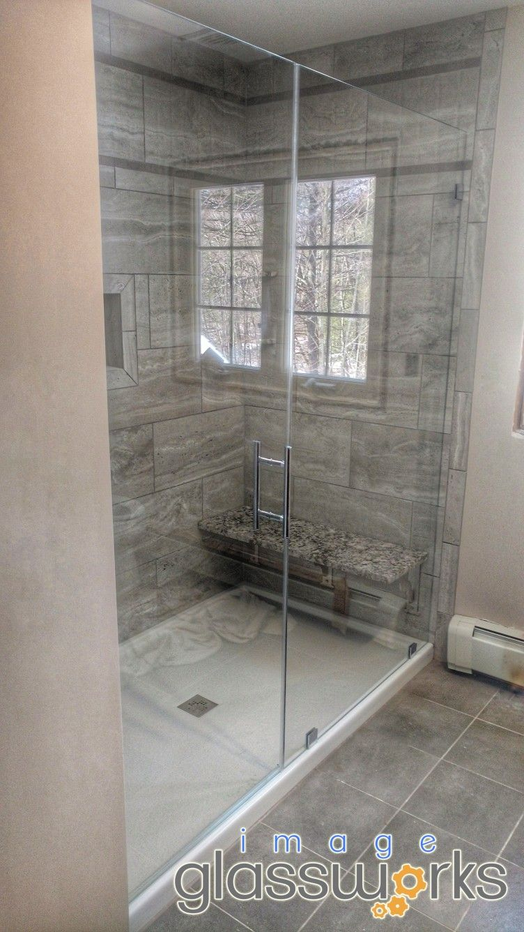 Simple And Elegant Frameless Door And Panel With A Ladder Style Pull Handle And Chrome Hardw Frameless Glass Doors Fireplace Glass Doors Frameless Shower Doors