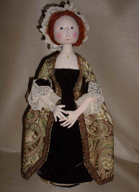 """Simplicity""  By Daria Cash    Cloth reproduction of a 1750's Queen Anne wooden doll, with a stump base for stability."