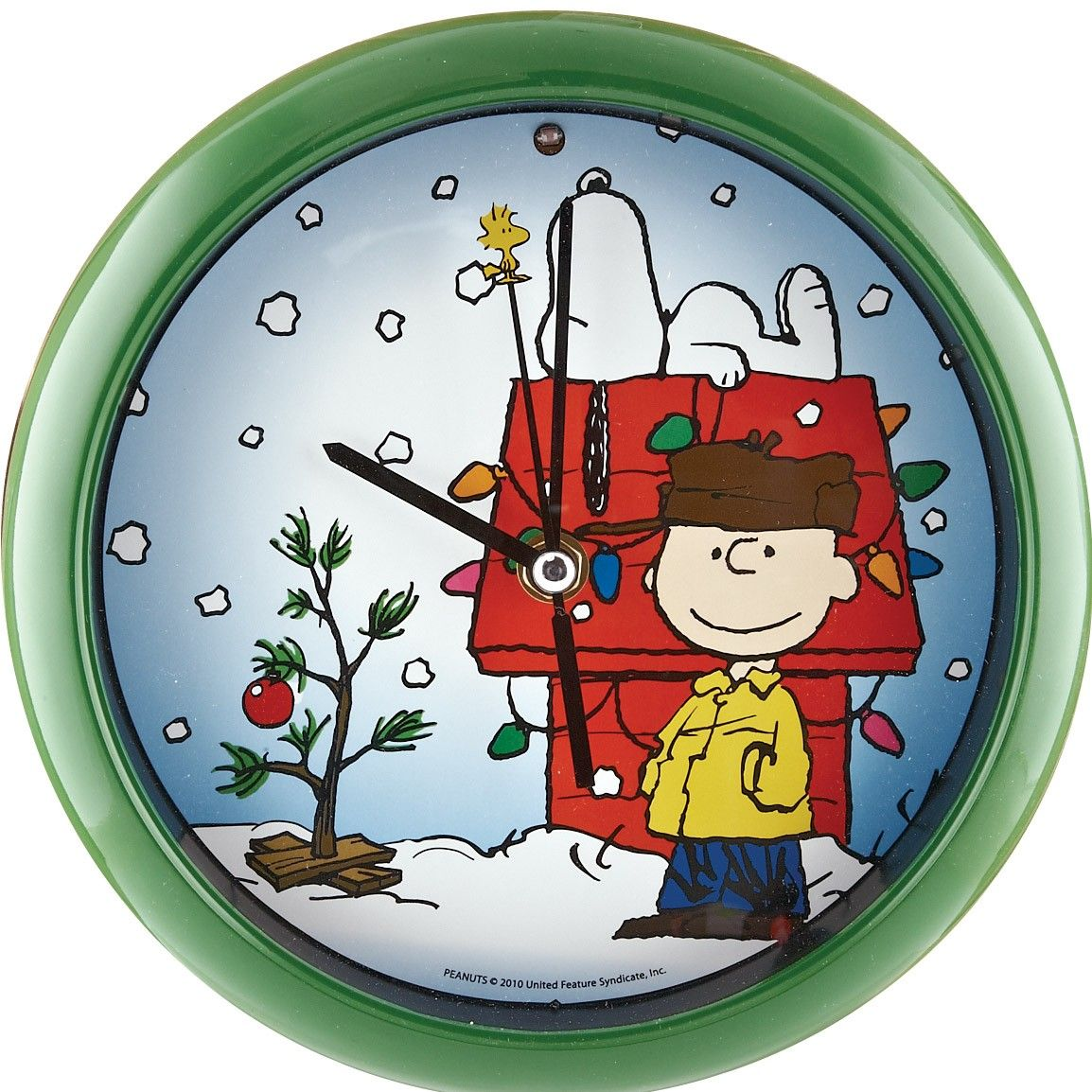 """[""""Celebrate the holidays with this cute Peanuts\u2122 Christmas Carol Clock! The face features ..."""