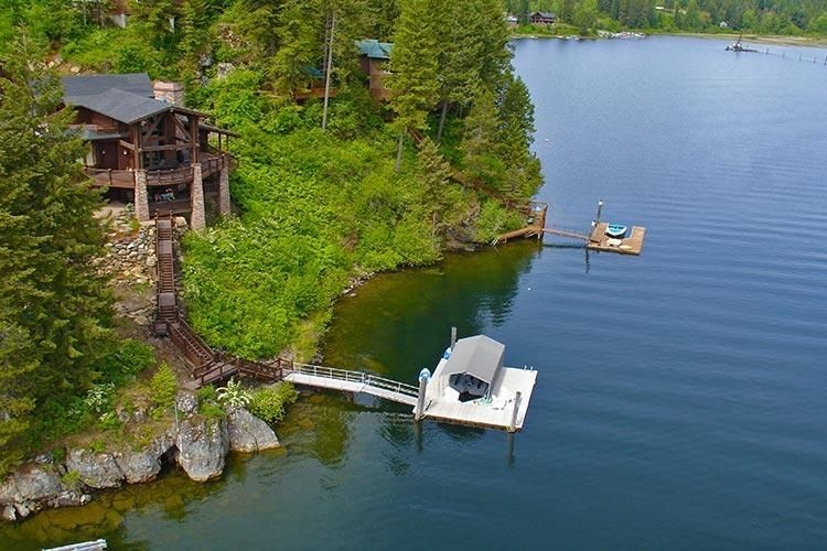 Coeur d'Alene Lake, Rockford Bay, 145' frontage, 4690 sq ft, High Quality Construction, 3 bdrms, 4 baths, 4018 sq ft, 2 car detached garage with 672 sq ft (1 bdrm, 1 bath)guest quarters above, paved driveway, community water and sewer, dock/boat slip, great deck, fire pit.