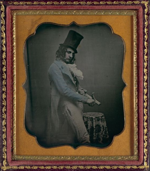 """ca. 1850-55, [portrait of a gentleman as the ""wily Yankee""]    The ""wily Yankee"" was a popular 19th century stage character who became the visual predecessor to ""Uncle Sam."" Between acts, the wily Yankee remained on stage, whittled, and told parables. At times, he was known to flirt with both the women and men in the audience as he suggestively carved a stick."""