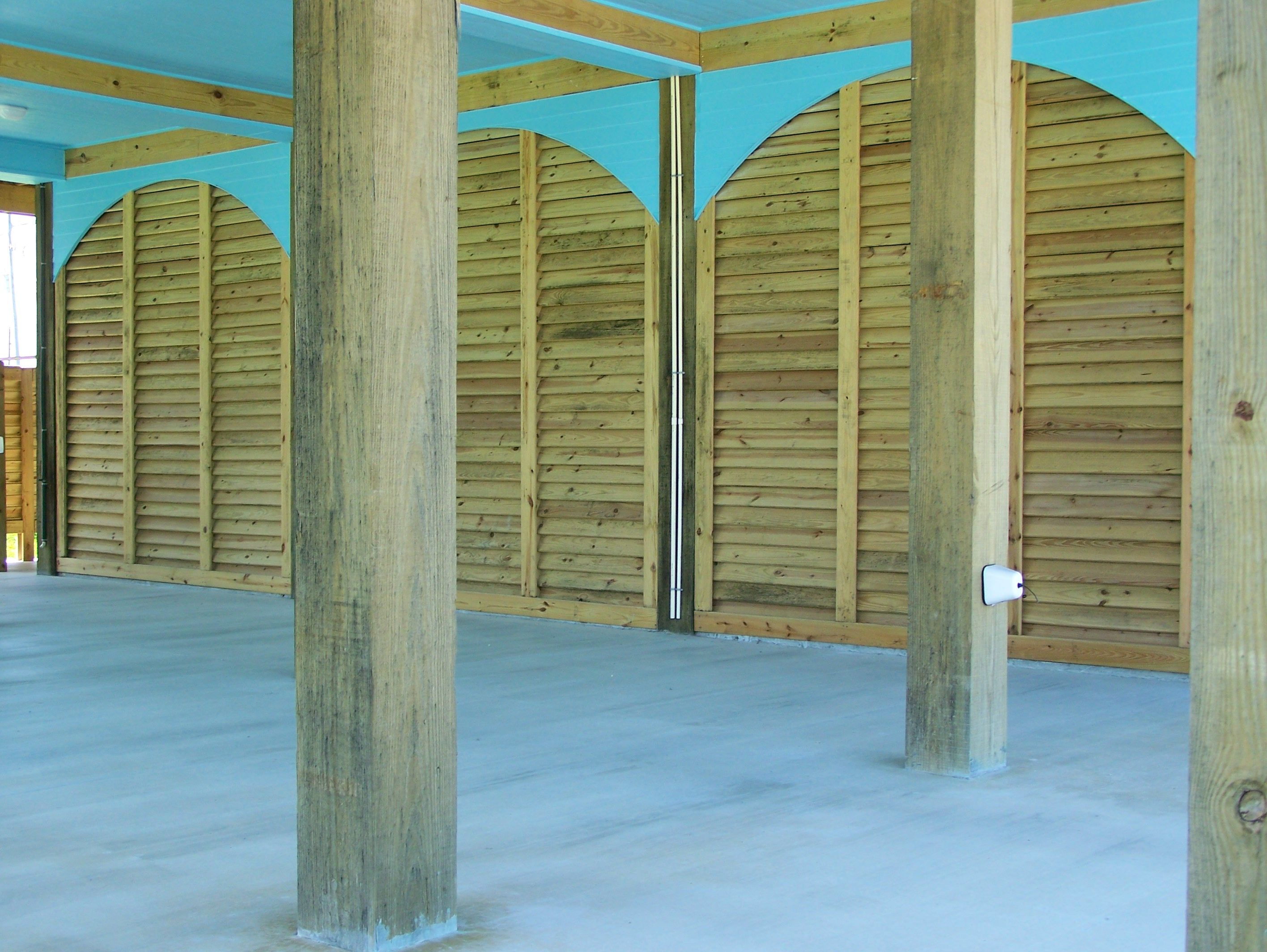 Break Away Wall Required On The Coast Arched Louvered Garage Panels Coastal Cottage Custom Home Builders Home Builders