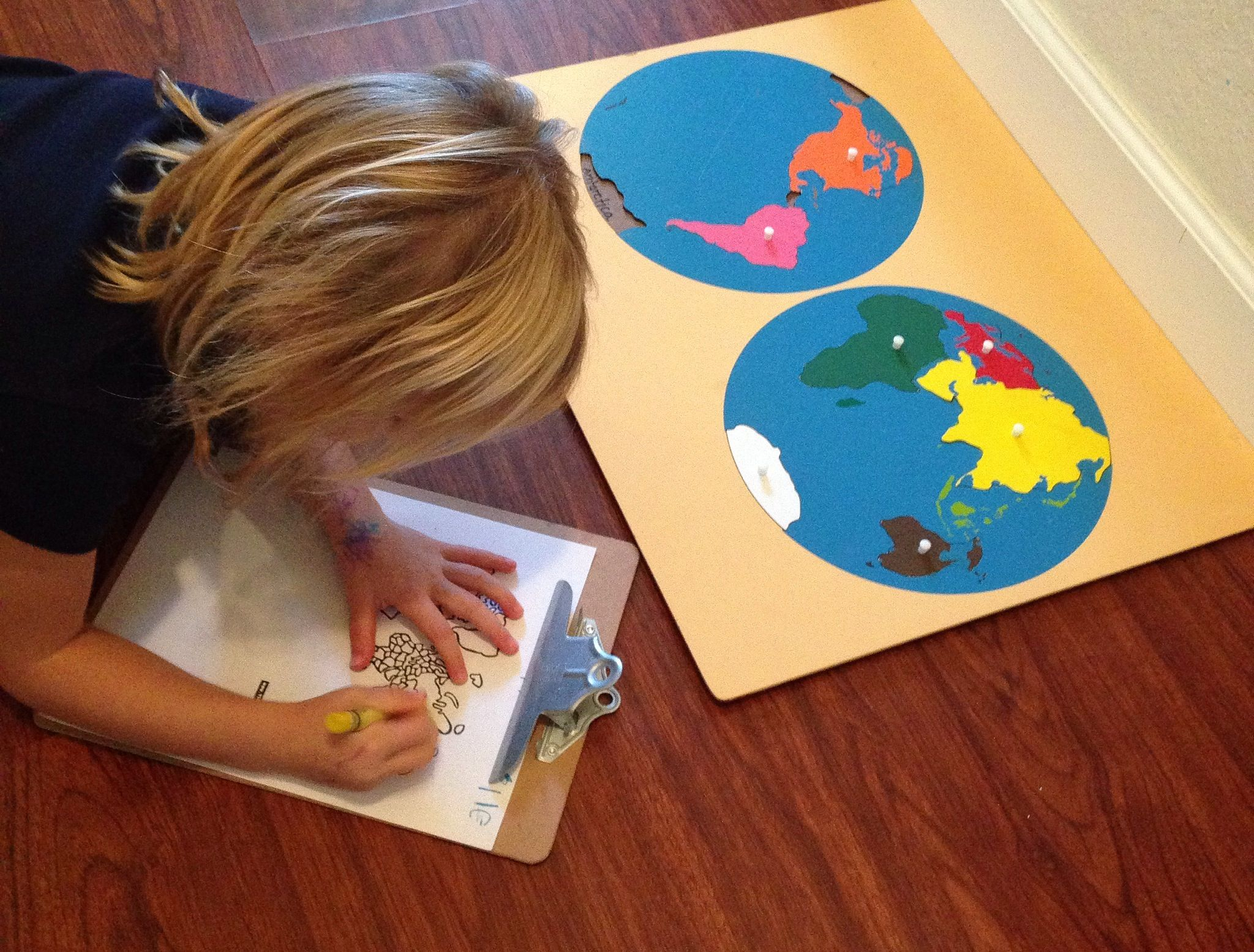 Our Homeschool Day Using The Montessori Continent Puzzle