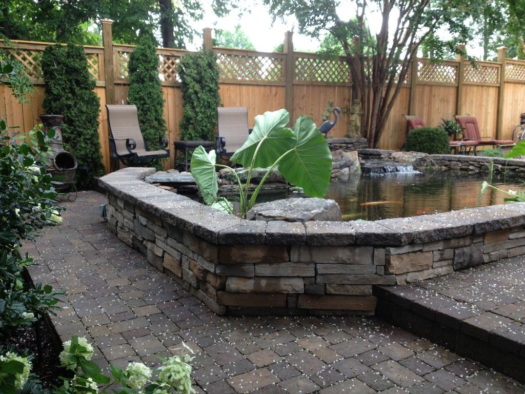 Raised pond home garden pond design ponds backyard for Outdoor pond