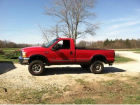 14. 2000 Ford F350 4x4 modified pick-up - Anne