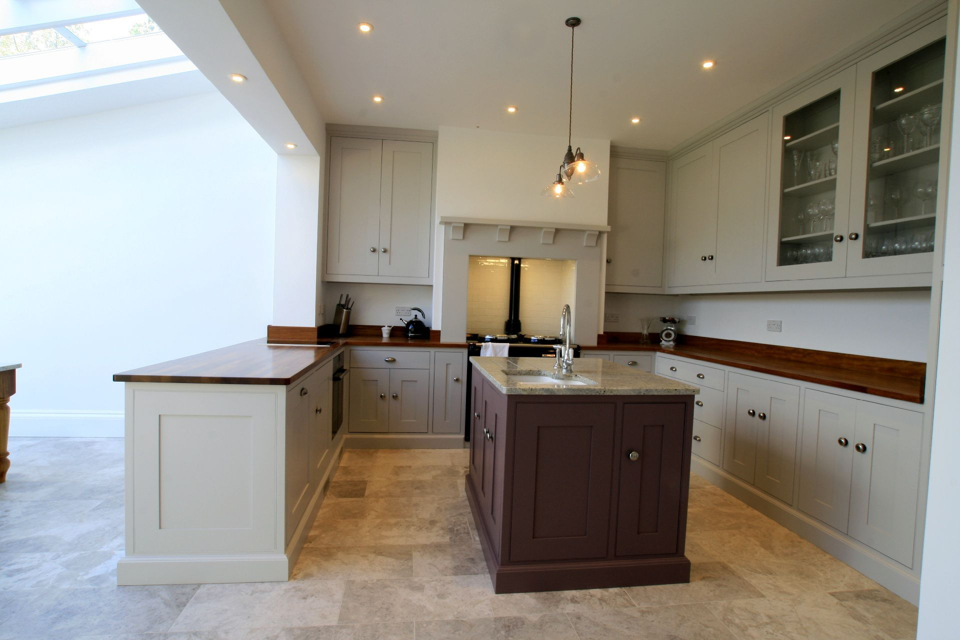 Shallow depth cupboards in front of chimney breast