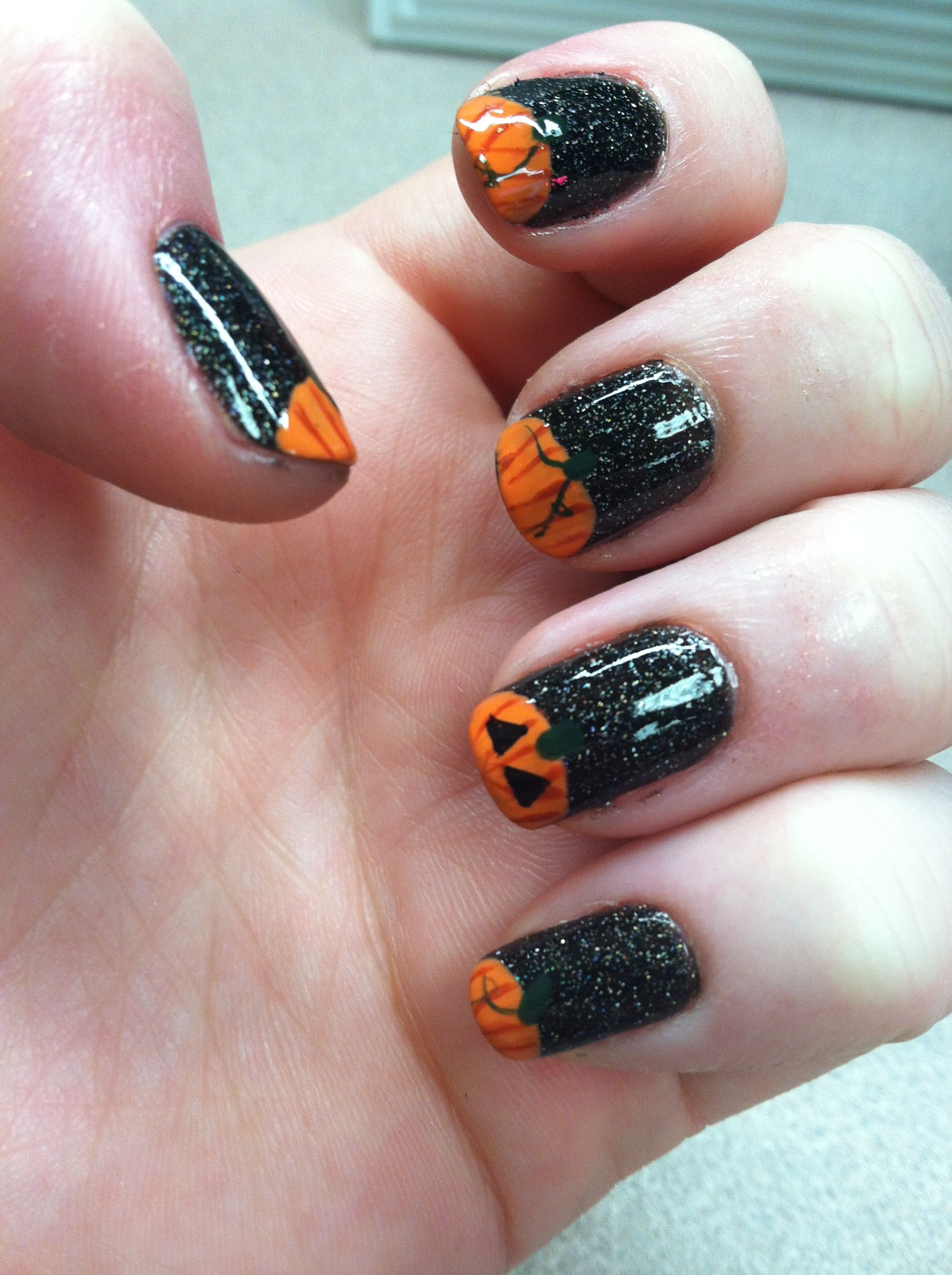 Halloween nails. Zoya storm (glittery black) with orange ...