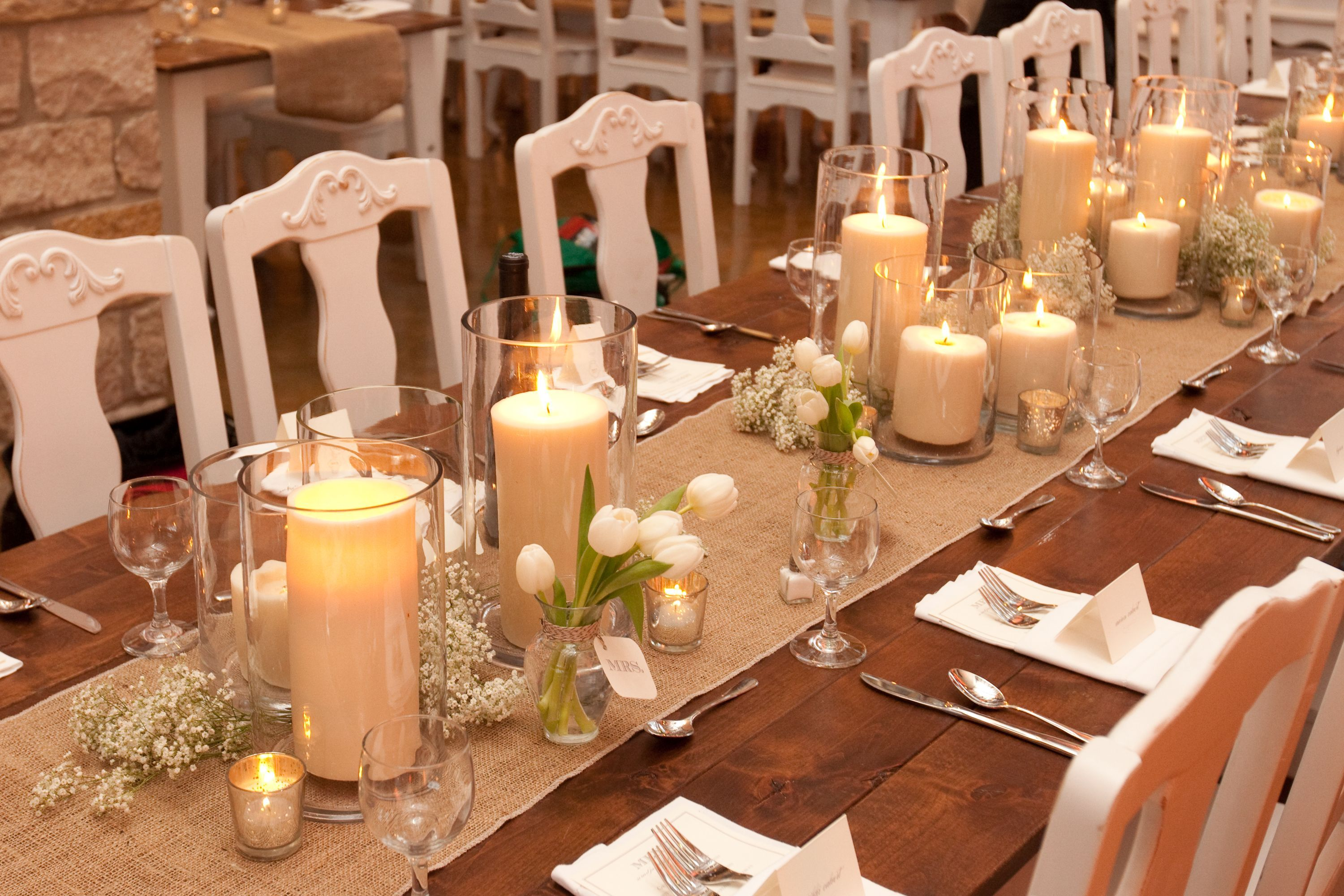 The Long Tables Will Have Pillar Candles In Vases At