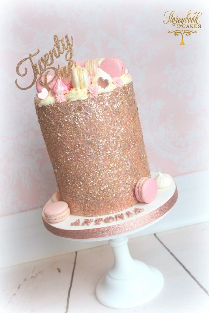 Tall rose gold glittery birthday cake with macarons ...