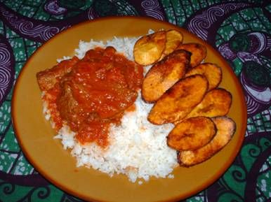 Typical Nigerian Dish Plantain Tomato Stew And Rice Nigerian Food Ethnic Recipes Food