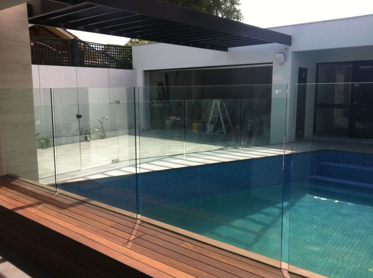 Frameless Glass Pool Fencing In Glazing Channel On Deck And Paving Glass Pool Fencing