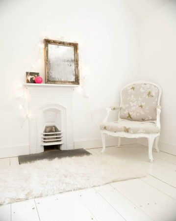White/armchair/fireplace
