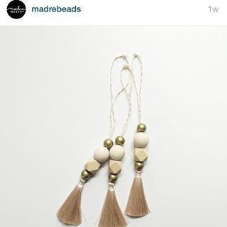 Sooo my favorite shop of mom/kid/baby friendly necklaces @madrebeads launches her winter line on Wednesday the 18th and I'm so excited. Because this new house needs a Christmas tree, ASAP, and I simply must have these ornaments. Or maybe I'll hang them on the mantle with the stockings. As an added bonus they have a diffuser bead so they can also make my house smell amazing. Oh decisions decisions... #madrebeads #ourhouse #madrebeadswinter #christmastreedecoration #madrebeadsambassador
