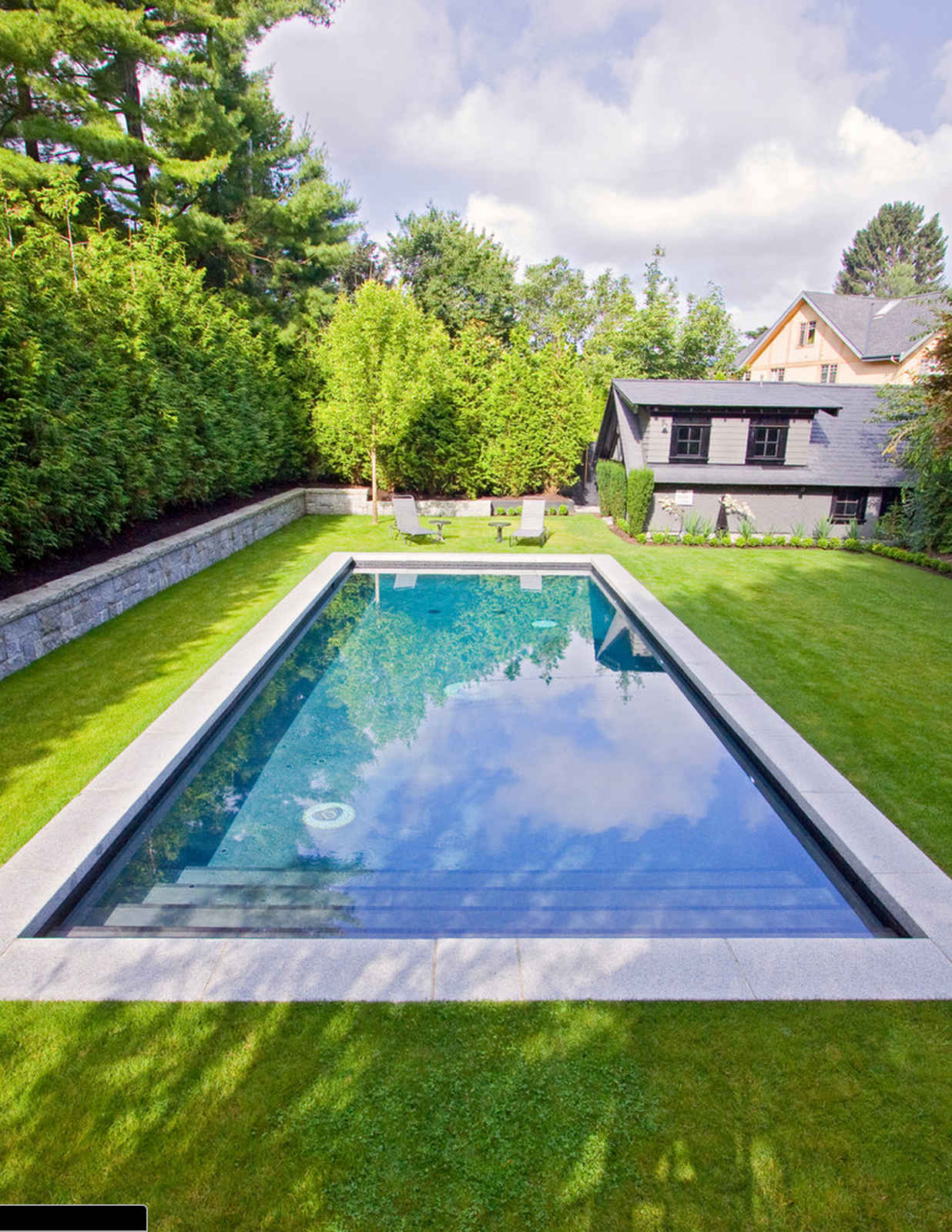 Simple rectangle pool surrounded by grass pool for Simple backyard pools