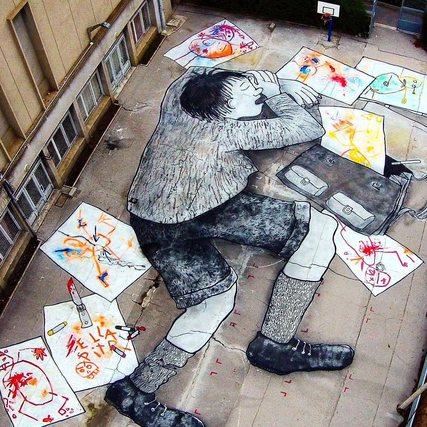 Ella & Pitr are back on the streets of their hometown, Saint Etienne in France where they just finished working on this impressive and amazing artwork. Known for their storybook-like illustrations, the French street art duo painted this enormous piece showing a young kid taking a rest after a series of mischief on paper.