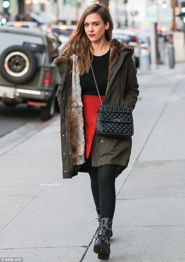 Jessica Alba is feeling festive in red skirt and