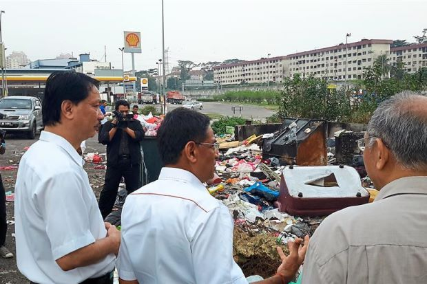 Play part to combat rise of dengue, health experts tell public.   Eyesore: Dr Subramaniam (centre) looking at heaps of rubbish near the Taman Taming Jaya flats in Balakong. With him is health director-general Datuk Dr Noor Hisham Abdullah (left).