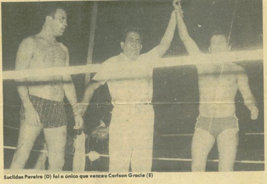 Luta Livre practicioner Euclides Pereira victorious over Carlson Gracie. Luta Livre was a style created in Brasil from Catch-Wrestling, Judo, and their own innovations. It was a rival style with Gracie Jiu-Jitsu. Other notable practitioners include UFC champion Marco Ruas.