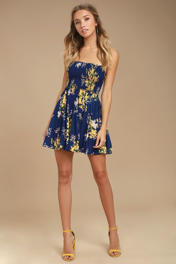 61a1154c5b8d The perfect sundress is at your fingertips with the Fairytale Bliss Navy  Blue Floral Print Skater Dress! Woven rayon in a yellow, pink, and green  floral ...