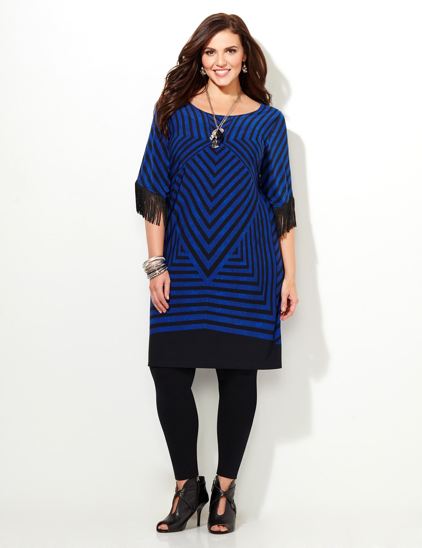 Illusive Fringe Dress | Catherines  Our Art Deco inspired dress has an allover geometric print with a bold pop of color. Fringe lines the sleeve ends for a awe-inspiring finish. Scoop neckline. Short sleeves. Catherines dresses are expertly designed for the plus size woman. #catherines #catherinesplus #plussize #plussizefashion #fringe