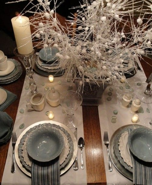 Grey, white, and silver colors pulled together to make beautiful winter wedding decorations.  So elegant and adds a little edge to the typical traditional look.