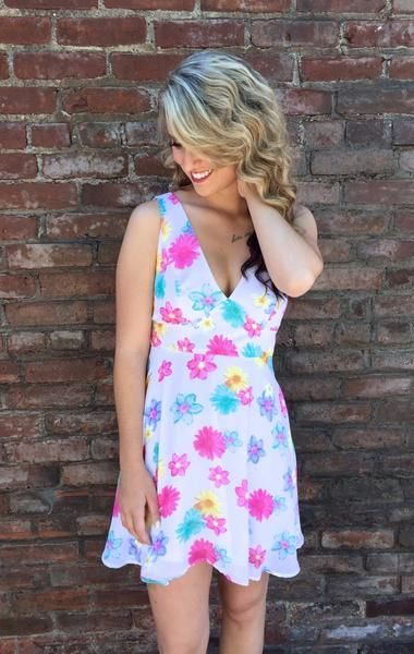 We are loving this floral print dress with its bright colors and fitted waist, it is definitely flattering to the figure. V-neck and back, zipper at back center, fully lined.