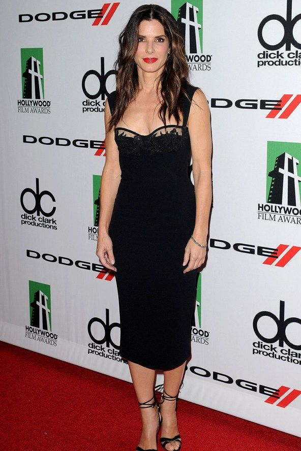 Sandra Bullock wore a Dsquared2 spring/summer 2014 black dress with Martin Katz jewellery.    Slammin'!