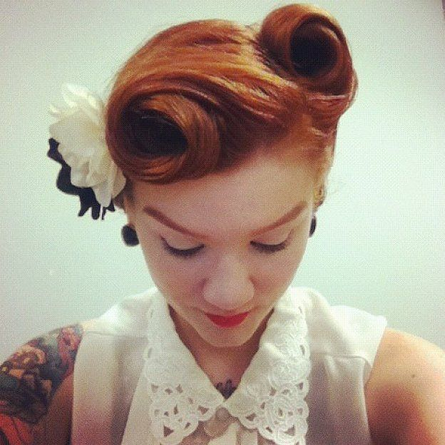 Victory rolls short hair with flower for straight hair