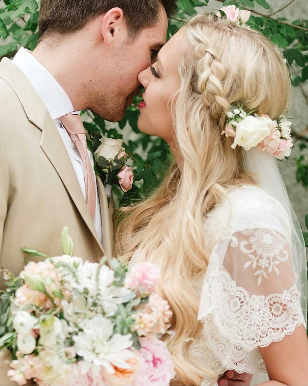 Boho modest wedding dress with flutter sleeves and a flared skirt