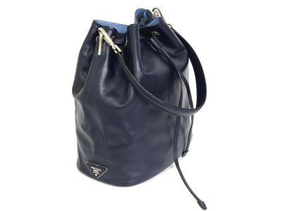 BAG, PRADA, bucket model, dark blue leather, pale blue lining fabric, details in base metal, 26x31x15cm, dustbag. #prada #bucketbag