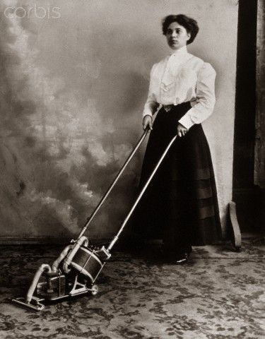 1900s Turn Of The 20th Century Anonymous Unidentified Woman Using Antique Manual Vacuum Carpet Sweeper Cleaner